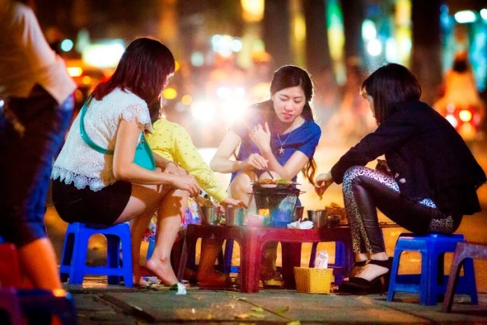 Enjoy The Taste Of Hanoi Street Food on a Motorbike